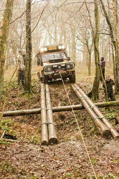 96 Land Rover Defender 110 300tdi. Tackling a log bridge #racetrack #autoracing http://perrisautospeedway.com