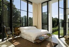 Fantastic floor-to-ceiling windows, although it might feel like you are sleeping in the university library....Waterfront House, East Hampton, NY