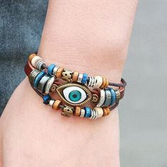A soft faux leather band and a myriad of textured beads saturate this rustic wrap bracelet in luxe eccentricity. - Bracelet: 7.5'' L to 10.25'' L - Charm: 0.63'' W x 0.63'' L - Adjustable - Man-made /