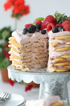 This Ritz Cracker and Mixed Berry Icebox Cake is the perfect dessert for summer entertaining. from @inspiredbycharm