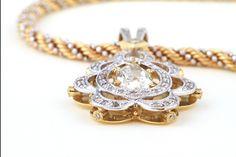 Fancy yellow pear shape diamond pendant by GALACIA DESIGNER JEWELLER.Y