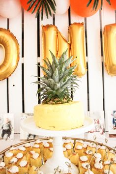 Tropical themed first birthday party smash cake // megmcmillin.com