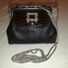 """Brighton Two Tone Crossbody Coin Purse Brighton Black and Brown Leather Kiss Lock Crossbody Coin Purse has a front snap closure compartment, a top kuss lock compartment with an ID slot, can be used as an evening purse.  Height 4.5"""" Depth 2"""" Length 5"""" Strap Drops 14"""".  In very good condition. Brighton  Bags Crossbody Bags"""