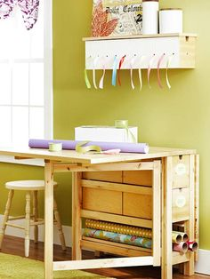 A wrapping/cutting station that remains almost flat to the wall when not in use! Me likey a lot!