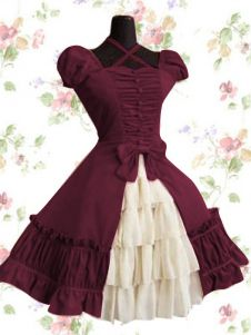 Wrath's dress style - lolita fashion mixed with schoolgirl uniforms, always a filled skirt.