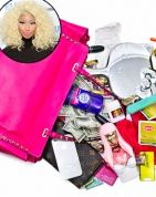 "Nicki Minaj The Bag: Valentino Rockstud tote The Essentials: ""I don't put cash in my Louis Vuitton wallet,"" explains Minaj, who also stashes Throat Coat tea, ""at least MAC Viva Glam lipsticks and deodorant in her bag. What's In My Purse, Whats In Your Purse, What In My Bag, What's In Your Bag, Viva Glam Mac Lipstick, Brown Coach Purse, Boho Bags, Louis Vuitton Wallet, Celebrity Beauty"