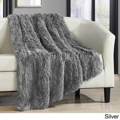 Beautifully textured, this Juneau Shaggy Faux Fur Throw Blanket from Chic Home is perfect for cuddling up with. Made of luxurious faux fur, this sumptuous blanket is soft, ultra-plush and beautifully