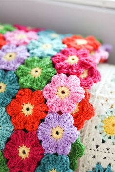 I'd like to make this blanket with little garden plots of flowers.