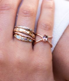 This radiant ring is a must-have!The beautiful 14k Rose Gold double band is dusted with .07 carat diamonds at its face. This draws everyone's eye to the flawless .53 carat Tourmaline stone. Handmade