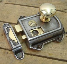 Victorian Rim Latch Set - The Victorian latch is cast iron with brass fittings.  It is dual handed and has a traditional thumb nail latch. Each lock is hand finished and is supplied with a lock keep. You can have it without knobs or choose from three different types.