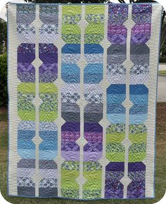 This pattern is so straightforward, basically a fancy coin strip-- wish I'd have thought of it. Great way to showcase prints from a line, too. Blogged by Quilt Dad(.com) for Fat Quarterly