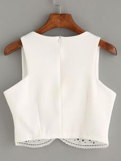 A sweet and trendy little crop top for any summer day or night. DESCRIPTION Fabric:Fabric has some stretch Season:Summer Lining:YES Color:White Pattern Type:Plain Neckline:Spaghetti Strap Material:Pol