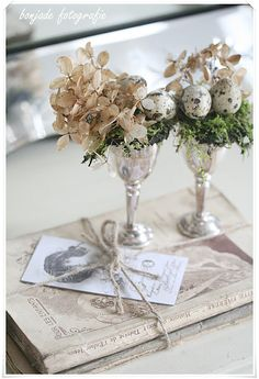 Original Easter decoration silver vases, dry flowers, and small eggs