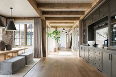 I like the different materials on the ceiling. The beams make the space feel cozier House styles SM Ranch House: Entry, Dining Küchen Design, House Design, Wooden Table And Chairs, Living Spaces, Living Room, Style At Home, Home Remodeling, House Renovations, Kitchen Renovations