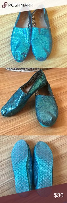TOMS Teal glitter slip-ons TOMS teal glitter shoes. Size 9.5. Worn once. Received as a present and super cute, just too big for me. TOMS Shoes Flats & Loafers