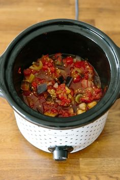 This classic summer Italian recipe couldn't be easier! How To Make Caponata in your slow cooker or crockpot. Recipes like this are essential to have on hand in the summer to help use up all those tasty farmers market vegetables. You'll need eggplant, roma tomatoes, onions, celery, tomato paste, red wine vinegar, golden raisins, capers and pine nuts.