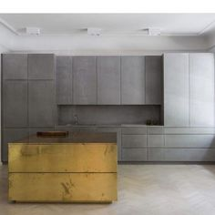 Gold and grey apartment | grey valchromat concrete and brass by Richard Lindvall…: