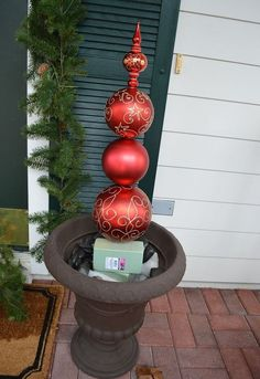 DIY Christmas Ornament Topiary - - I have been wanting a Christmas ornament topiary since I first saw them in holiday decorating catalogs, but have you seen the prices? I decided to customize my front porch decor this holiday season. Christmas Topiary, Christmas Garden, Outdoor Christmas Decorations, Diy Christmas Ornaments, How To Make Ornaments, Christmas Angels, Christmas Holiday, Porch Ornaments, Weekend Crafts