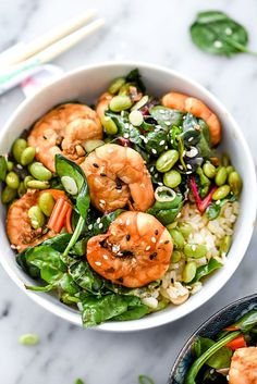 This quick meal in a bowl of shrimp seasoned in sesame flavors is stir fried with rainbow swiss chard, spinach, edamame, green onions to top brown rice.