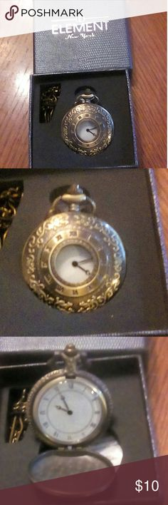 E Element New York Pocket Watch w/Chain. NIB E Element New York Pocket watch with chain. NIB. Bronze Color. Opens with a button at the top. Smoke free home. Roman Numerals. Had minute and hour hands. Needs batteries E Element New York Accessories Watches