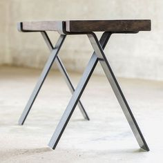 """Bold MFG is proud to offer our Cross Legs from the Flatform series. This set of bench legs is cold formed from 3/8"""" x 3"""" flat bar steel and receives a oiled finish that is well suited for indoor use."""