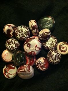 Handmade polymer clay beads in crimson white n some in black..