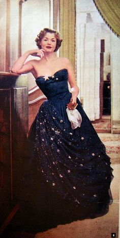 1950's Balmain strapless gown in midnight with gold stars adorning the milky-way.