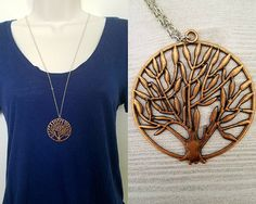 Necklace details:  • Pendant is antique copper-colored tree of life • Pendant is 1.75 in height and 1.75 in width • Chain is antique silver-plated tiny flat soldered cable chain 2x1.4mm • Necklace is 30 with 2 extender chain and lobster clasp closure • Lead safe, nickel safe • Base metal of chain is brass  Other information:  • Every purchase from our shop supports nature-related organizations • This necklace is part of our Into the Woods collection, and supports rainforest conservation in…