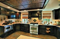 Copper ceilings look so nice in kitchens, though prefer copper ceilings in a wooden,cabin type decor