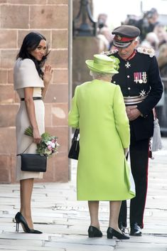 Queen Elizabeth II Photos - Meghan, Duchess of Sussex waves as Queen Elizabeth II speaks with the Lord Lieutenant as they leave Chester Town Hall on June 14, 2018 in Chester, England. Meghan Markle married Prince Harry last month to become Meghan, Duchess of Sussex.