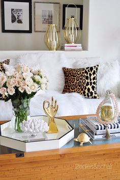 Take beautiful flowers and put them in a simple elegant clear vase from HomeGoods. Then shop HomeGoods for amazing gold accessories and trays. It's that easy to have your coffee table decorated. Sponsored by HomeGoods