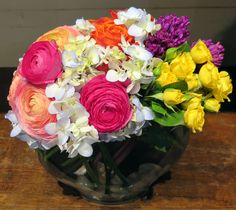 A truly radiant variety - ranunculus, hydrangea, roses, and hyacinth
