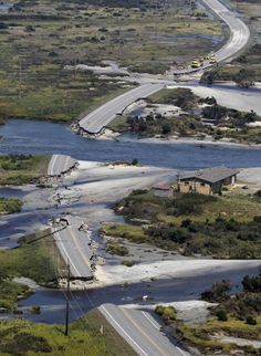 Officials survey the damage to route 12 on Hatteras Island, NC., Sunday, Aug. 28, 2011. Hurricane Irene swept through the area Saturday cutting the roadway in five locations. Irene caused more than 4.5 million homes and businesses along the East Coast to reportedly lose power over the weekend. #news #irene