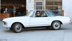 Best Car ever ! They see me rolling: Harry looked like the perfect rock star in his RayBans, headscarf and...