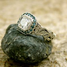 0.92ct Diamond Leaf Vine Platinum Engagement Ring with Teal Turquoise Blue Diamonds in Halo and Milgrain Antiquing. $6,020.00, via Etsy.