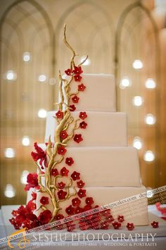 Tiered cake with Red flowers & gold branches. So cute! But I would do yellow and green flowers