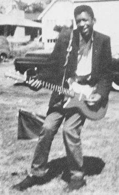 Jimi Hendrix with his first electric guitar, 1957