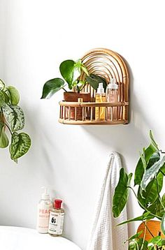 Wood  cotton netted 3tiered hanging basket found exclusively at UO. Three concentric baskets in a tiered construction perfect for displaying fruit  plants in the kitchen with cotton net for base  edges with rounded wooden structure. Hanging hardware not included. Content  Care    Cotton wood    Spot clean    Imported   Size    Dimensions 8.5dia x 30.5h    Shelving weight limit 13 lbs    Weight 1 lb Urban Outfitters Bedroom, Circle Shelf, Fruit Plants, Hanging Baskets, Wall Shelves, Rattan, Cleaning Wipes, Floating Shelves, Bamboo