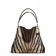 26ee3b5a26 The Madison Small Phoebe Shoulder Bag In Zebra Print Fabric from Coach need  this one too.with matching wallet