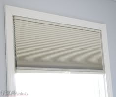 Amazing Window Treatment Makeover with a blackout cellular shade from Blinds.com and a few other touches.