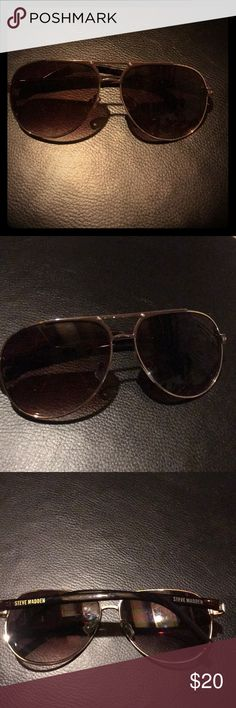Aviator Steve Madden Sunglasses with Gold Rims!!🍒 These sexy Steve Madden Aviator sunglasses are in great shape with no damage to the lenses or rims.  The gold metal trim looks sharp, and the nose pads are still in tact and make the fit of these frames so great!  These glasses have brown arms with Steve Madden printed on both sides.  The small detail on the sides looks so cool!  Great gift idea!  😎 Steve Madden Accessories Sunglasses