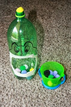Froggie Pompom Drop - made from empty soda bottle.  Use it to develop fine motor skills in toddlers.  Also great for practicing counting and colors.              # easy at home activities # 18 24 months 2 year old