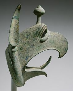 Head of a griffin from a cauldron, third quarter of 7th century b.c.  Greek (from Olympia)  Bronze