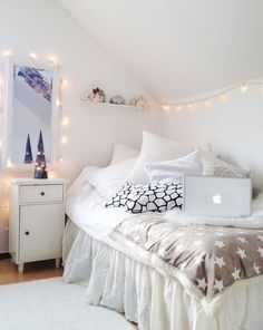 White Bedroom. Love fairy lights. Cute for a little girls room- fairy lights instead of a nightlight