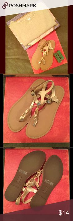 Gold Sandals by Old Navy Gold Thong Sandals by Old Navy. Worn once. If you purchase these sandals you will be getting the gold sheer blouse shown in this picture and the two safety pin bracelets. The blouse is a size medium but runs a little big.😘🦋 Old Navy Shoes Sandals