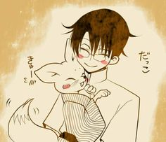 xxxHolic ~~ Watanuki and the adorable chibi Kitsune having a snuggle.