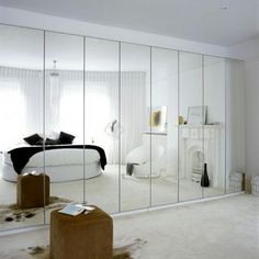 Mirrored storage kills two birds with stone, and creates a light, bright and airy bedroom. - PUT MIRRORED DOORS ON Airy Bedroom, Master Bedroom Closet, Bedroom Wardrobe, Trendy Bedroom, White Bedroom, Bedroom Wall, Bedroom Decor, White Wardrobe, Bedroom Storage