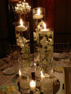 an elegant and classic centerpiece of submerged orchids and floating candles.