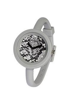 """Reloj IO?ION!, modelo POD GRIGIO SNAKE, analógico. Diseño redondeado, esfera con dibujo piel de serpierte y correa en color gris, con cierre de clip regulable (cada 5 mm). Diseño ergonómico y ultraligero. Ultraplano. Talla única con pulsera ajustable con hebilla. UNISEX. Sumergible (hasta 30 m. de profundidad). FUNCION """"YES WE CHANGE""""."""
