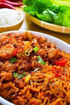 Dakgalbi (spicy stir fried chicken with noodles and rice)